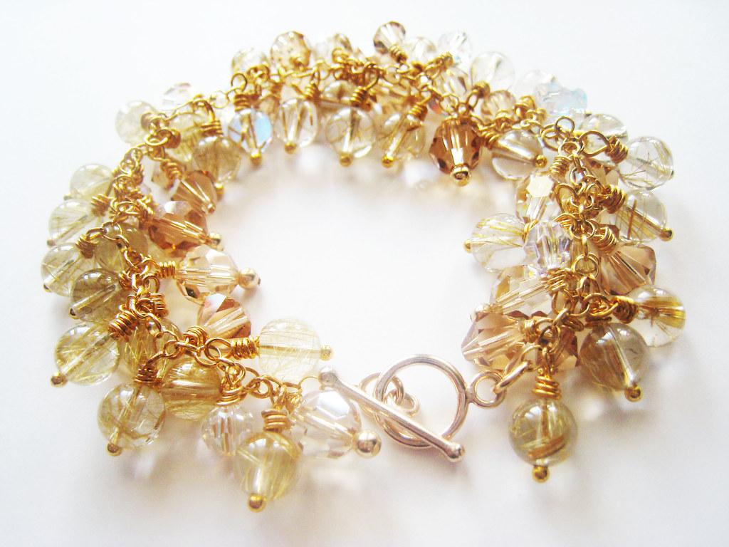Golden rutilated quartz and crystal bracelet