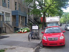 There are so many bicyclists in Montreal that there are public bike racks installed in neighborhoods