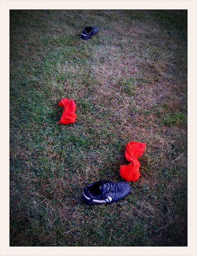 Found footwear: A pair of football boots and red socks