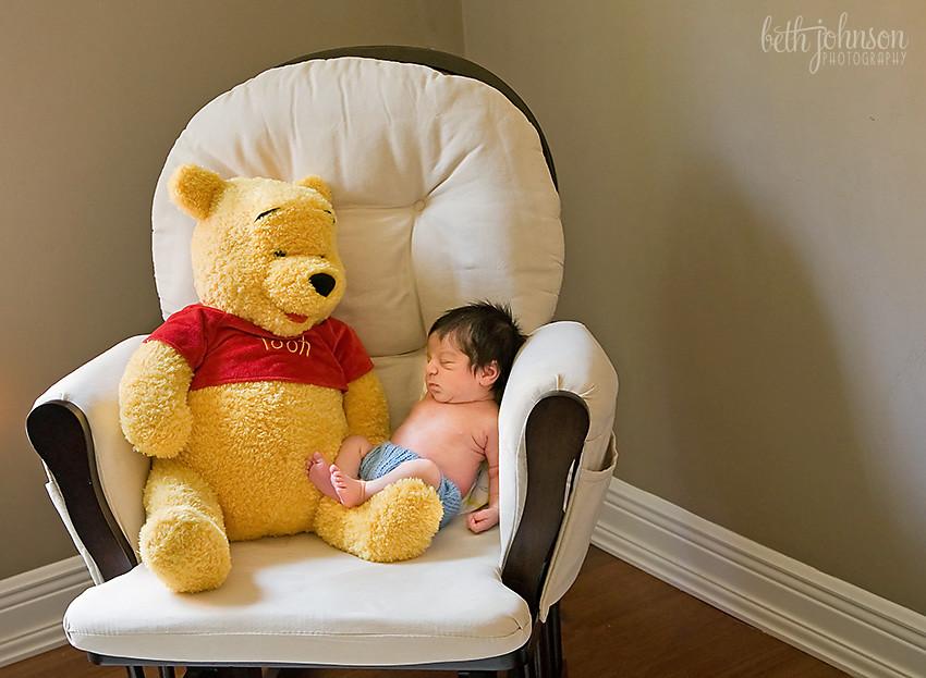 newborn baby boy with winnie the pooh