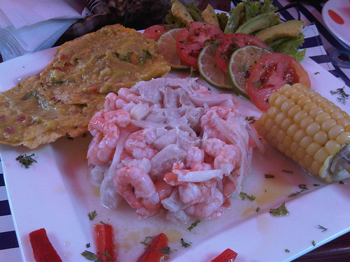 Peruvian ceviche of fish and shrimp, served with plantains and salad.
