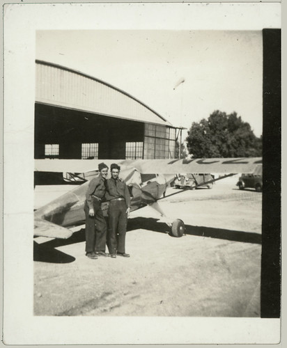 Two men and a light plane