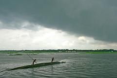 Window to Bangladesh [1] (Shimul Kibria) Tags: green water rain clouds canon river landscape pull photography cloudy ngc dhaka raining pulling punting bangladesh punt rainyseason drizzling uttara canoneos400ddigital flickraward canonefs1855mm3556 shimulkibria kanchkura