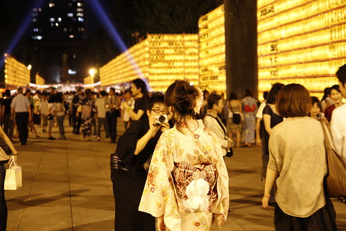 Girl in Yukata having her photo taken by lover (Mitama Festival 2010)