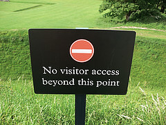 A sign in a field which says: no visitor access beyond this point