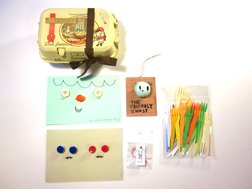 Egg carton, cute buttons, forks, Ghosty, and peanut.