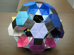 Rotunda-drilled-great-rhombicosidodecahedron-50-percent-complete.2 (Origami Tatsujin 折り紙) Tags: art colors paperart origami geometry great multicolored papiroflexia papercraft papercrafts polyhedra modularorigami geometricbeauty geometricart colorfulart rotundadrilledtruncatedicosidodecahedron