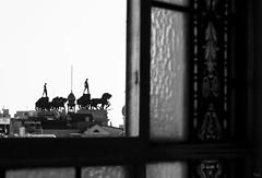 Voyeur (Yxola) Tags: madrid city windows summer sky bw building blancoynegro skyline ventana town cielo canon10d verano marco estatua cristal cba crculodebellasartes yxola edificiodelascudrigas