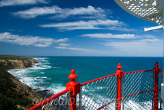 View from lighthouse (whitworth images) Tags: ocean old light red sea lighthouse white building heritage water coast waves view rail australia victoria lookout cliffs historic coastal maritime vic railing greatoceanroad southernocean beacon navigation vantage capeotway