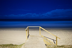 main beach entry (Pawel Papis Photography) Tags: ocean wood blue sky beach grass yellow night clouds stairs stars sand australia messy qld queensland rails footprint entry plywood handrails goldcoast mainbeach starrails
