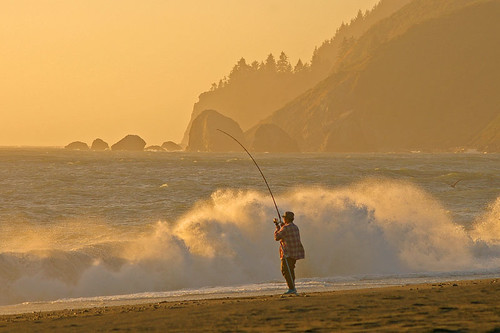 Fisherman on a Northern California coast. At sunset.