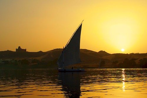 travel sunset tourism nature silhouette yellow river outdoors landscapes boat sand sailing desert dunes egypt historic international nautical aswan felucca nileriver