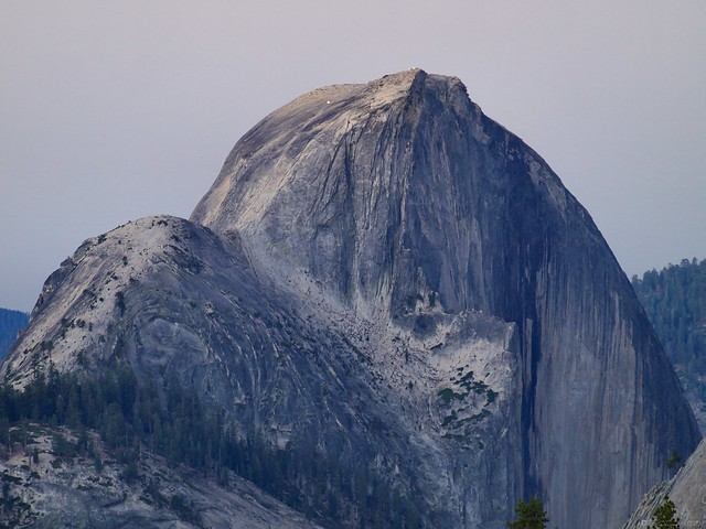 Hikers make the trek to the top of Half Dome in the predawn light.