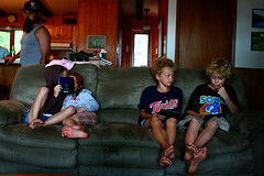 Gamers (TheOrganicSister) Tags: lake water wisconsin boat sam cousins ds rv zeb fotr unschooling keshena
