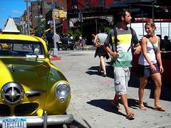 tacotaxi (omoo) Tags: auto newyorkcity girl car yellow vintage automobile couple taxi young champion streetscene romance sidewalk blonde happycouple studebaker greenwichvillage 2door physicalcontact calientecabco tacotaxi 195051 seventhavenuesouthandbleeckerstreet