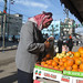 Elderly man shops for produce