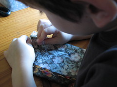 concentrating on sewing