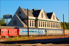Train Station and Train (Cliff Michaels) Tags: door morning windows red building architecture photoshop d50 nikon knoxville knoxcounty capturenx