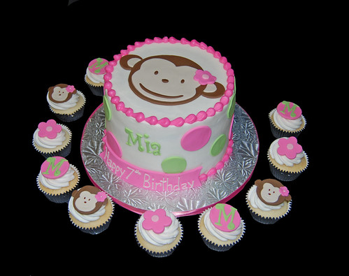 pink and green polka dot monkey cake and cupcakes