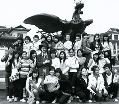 The Pepper Scholar and His Students (Brant Goble) (faith goble) Tags: china girls blackandwhite bw art college boys fountain students kids fun artist photographer dragon kentucky ky faith young son class teacher fieldtrip photograph american poet writer professor cowboyhat bowlinggreen outing hunanprovince goble faithgoble  brantgoble gographix faithgobleart