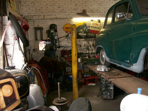 Old Vehicles and other paraphernalia in Aidensfield Garage, Yorkshire, England