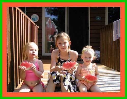 cousins having watermelon