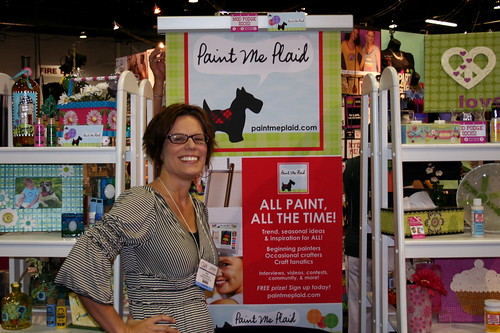 Amy in front of the Paint Me Plaid Banner