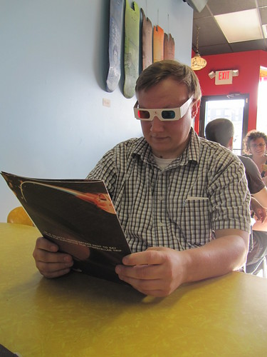 Aaron Reading the Galactic Pizza Menu