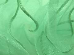Swirling Ribbon (jacknalfiesmum) Tags: blue sea green texture aqua waves pattern shine background material swirl ribbon curl coil coiled macromonday unusualperspectivebackground