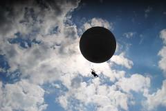 Eclipsed. (AustinGohn) Tags: blue sky people white clouds lens photography eclipse prague balloon manmade nikkor nikond3000 austingohn