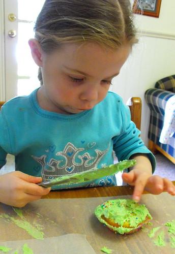 Amelia icing cupcake