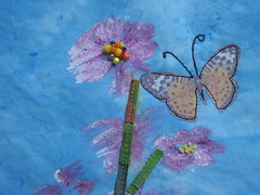 detail of mixed media flower and butterfly