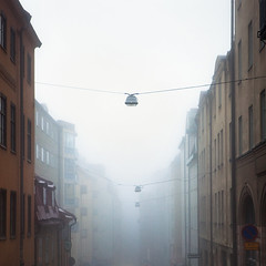 stgtagatan (Hannes R) Tags: street city morning autumn light mist building fall lamp fog buildings dawn lights town wire streetlight apartments apartment sweden stockholm sdermalm streetlights explore wires lamps frontpage mosebacketorg mosebacke stgtagatan