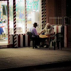 Domino (toddwshaffer) Tags: old nyc light color men shop brooklyn night canon 50mm dominican spanish barber williamsburg southside domino puertorican dominoes portugese