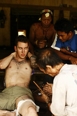 Mentawai tattoo (joeyL.com) Tags: lighting tattoo ferry trekking indonesia boat rainforest photoshoot traditional battery uma culture photographers tourists generator western hunter guide explorers healing behindthescenes ricky travelers translator shamanism solarpower sacrafice gatherer joeylawrence profoto elinchrom joeyl mentawai siberut stickpoke caleglendening gejeng willemisbrucker