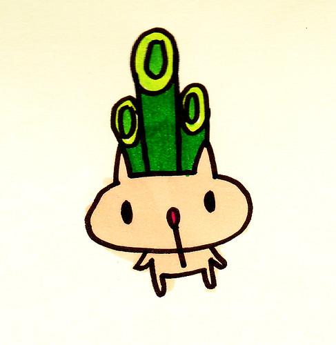 頭に大きな竹3本
