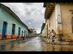 In the rain (Polis Poliviou) Tags: street boy man reflection rain bike bicycle by all  cuba streetphotography unesco communism fidel rights revolution trinidad caribbean che cuban plazamayor tobacco reserved cubalibre cheguevara polis embargo cubano caribbeanbeach rainning cubanrevolution republicofcuba spanishcolonialarchitecture republicadecuba sanctispritus lovelycuba exemplaryshots flickrsbestgroup afiap diegovelzquezdecullar unescosworldheritagesites poliviou polispoliviou  artistefiap   valleydelosingenios cubantown