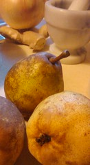 Bartlett pears with mortar and pestle in background