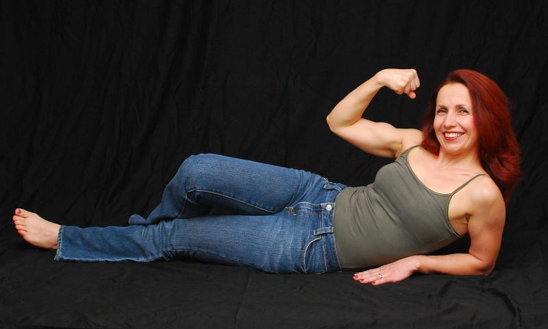 Laying around and flexing (luvtopose) Tags: woman girl muscles redhead flex  bicep