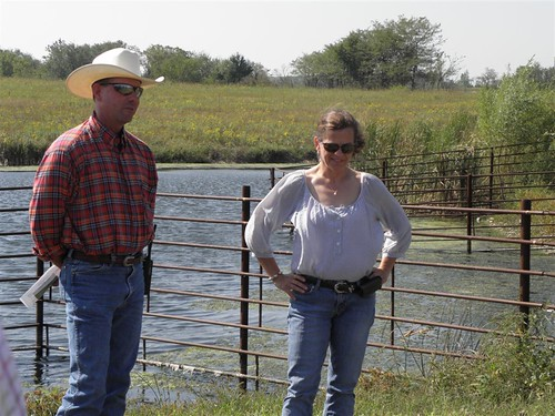 Joe Carpenter and Barbara Downey stand in front of their pond, which limits cattle access, prolonging the life of the pond and ensuring better water quality. The pride Joe and Barbara take in the care they provide both their animals and the resource base was evident, and they are communicating their love for the land to their two daughters as well.