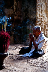 (Rachael Twells) Tags: people temple asia cambodia religion praying buddhism angkorwat nun incense d40