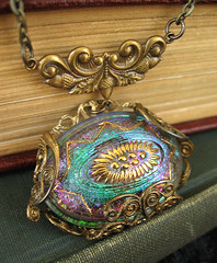 cathedralcupolanecklace4 (theothermagdalene) Tags: light necklace fantastic bright religion jewelry holy fantasy cupola mystical swirl iridescent christianity elysium scroll oval mystic shimmer elysia rosewindow coloful emeraldgreen spiritualexperience violetpurple czechglassbutton filigreewrap dichronicglass oxidizedbrass goldenbrass cathedralseries