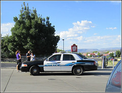 To protect and to serve... (twm1340) Tags: arizona ford call police ticket az victoria cop cottonwood vic crown cruiser officer arrest summons patrolman