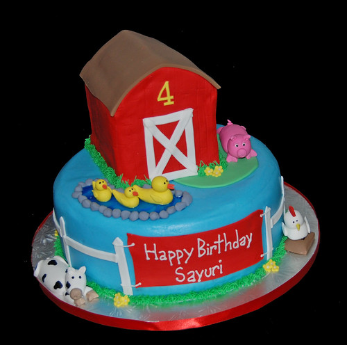 3D barn cake for a 4th birthday farm animal celebration