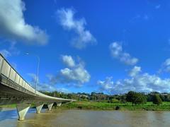Bridge to the sky (mpeacey) Tags: city bridge newzealand sky brown clouds river lumix high dynamic flood panasonic range palmerstonnorth hdr dmc manawatu summerhill palmy tonemapped manawatunz fitzherbert lx3