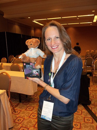 Andrea wins a Kodak M590 Camera and poses with EvaBear!