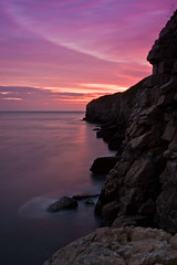 Jurassic Gargoyle, Dorset (flatworldsedge) Tags: longexposure sunset sea england cloud seascape crimson rock stone night clouds coast cloudy smooth magenta cliffs gargoyle dorset shape crags quarry jurassic explored portraitlandscape yahoo:yourpictures=coastal