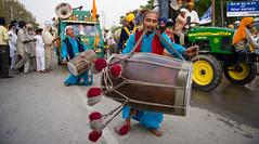 Big Drum Small World (gurbir singh brar) Tags: music drum percussion streetscene drummer punjab folkmusic punjabi 2010 dhol dholi sirhind fatehgarhsahib nikkor2470mmf28 gurbirsinghbrar nikond3s fatehdivas