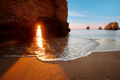 Bom dia, Portugal! (lichtmaedel) Tags: ocean morning sea sun portugal water beautiful sunrise star holidays algarve rise