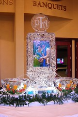 Fountain with picture frozen and Monogram engraved ice sculpture (Art Below Zero) Tags: wedding sculpture chicago ice bar bars carving milwaukee below banquet carver weddings centerpiece sculptures carvings icesculptures icesculpture centerpieces banquets lake zero  art carving wedding wedding ice sculpture weddings sculptor weddings geneva centerpiece luge luges
